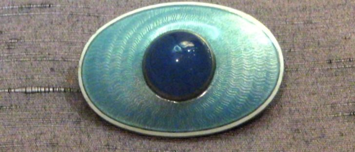 sapphirine, silver, and enamel brooch